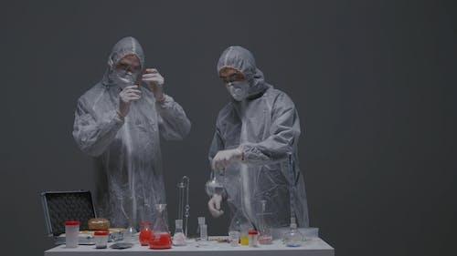 Chemist During Experiment