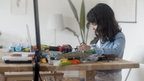 Girl Fixing Electronics