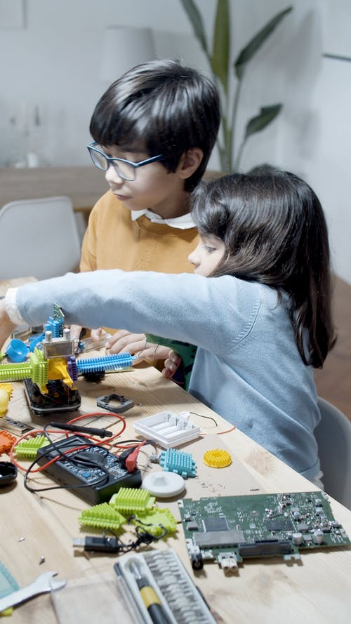 Girl and Boy Working with Hardware