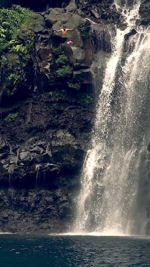 Man Jumping off Waterfalls