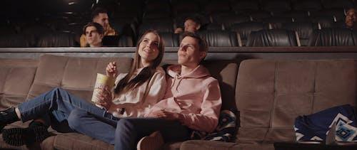 Couple Enjoying Eating Popcorn while Watching a Movie