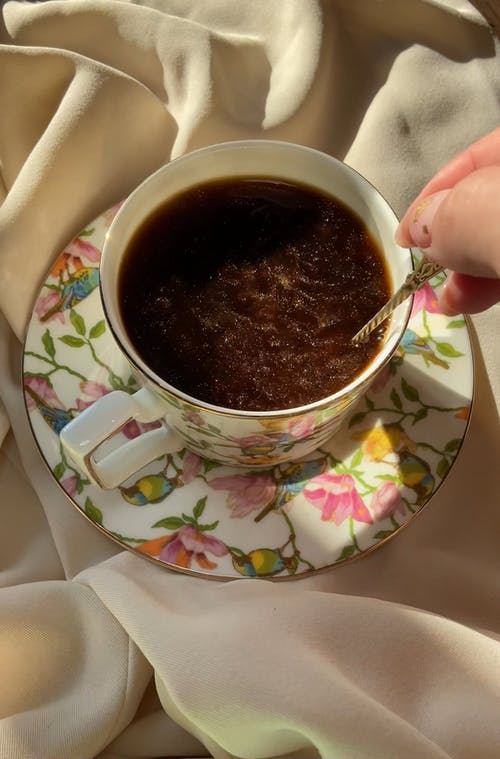 Close-Up View of a Person Stirring Coffee
