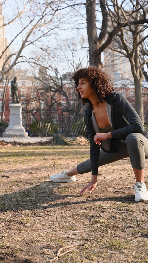 A Woman Doing Stretching in the Park