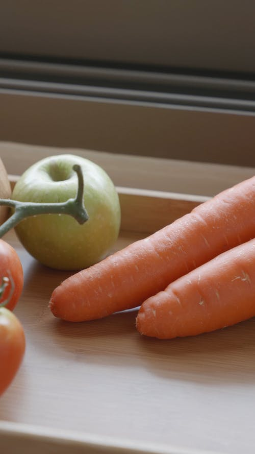 Fruits and Vegetables on a Wooden Tray