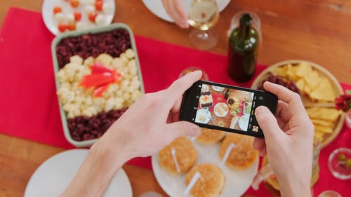 A Person Taking A Photo of the Food