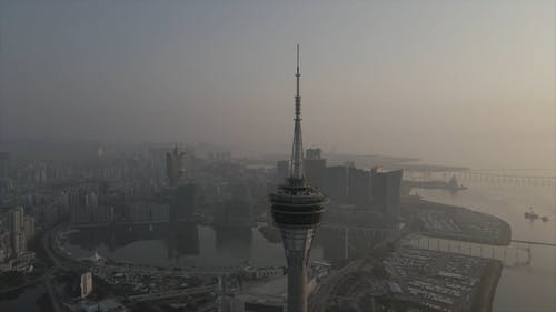 Drone Footage of a City on a Foggy Day