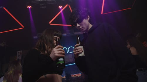 Young Adults Drinking Beer at the Club