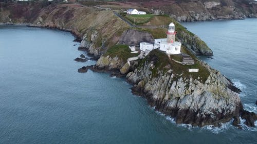 A Drone Footage of a Lighthouse on a Cliff