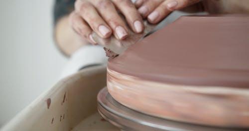 Person Making Ceramics
