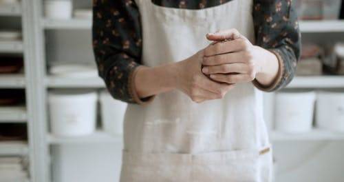Person holding Clay