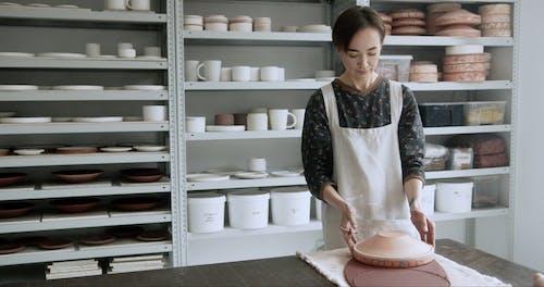 Woman Cutting Ceramic Clay