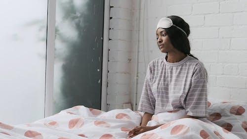 Woman Getting Ready to Sleep