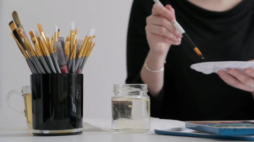 Woman Using Paint Brush and Palette Tray