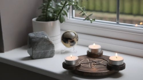 Small Lighted Candles by the Window