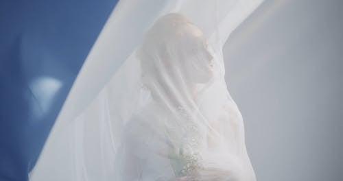 Woman Posing behind Curtain