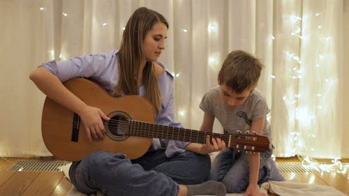Mother and Son Spending Time with a Guitar