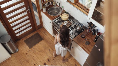 Woman Brewing Coffee in the Morning