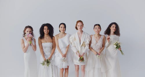 Brides Throwing Flower Bouquets