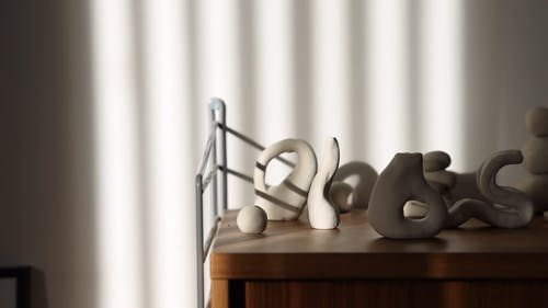 Various Small Clay Sculptures on a Table