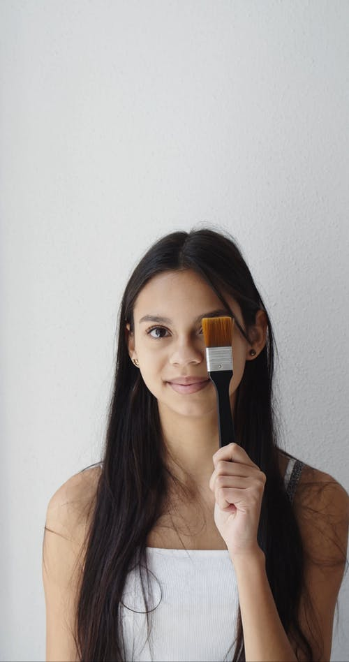 Woman Holding a Paint Brush