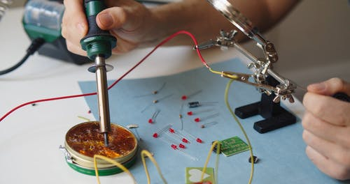 A Person using Soldering Iron