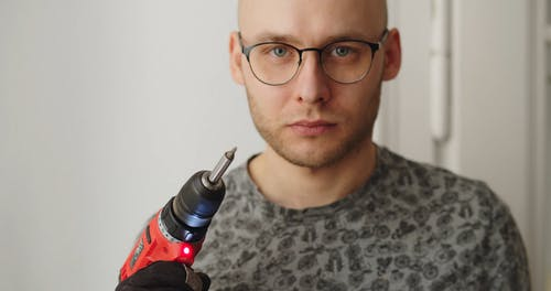 Man Holding an Electric Drill