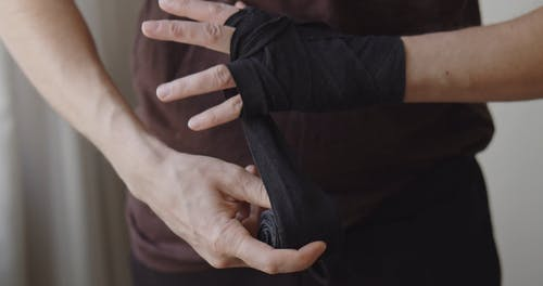 A Person Applying Bandage on Wrist