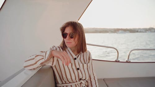 A Woman Riding a Boat