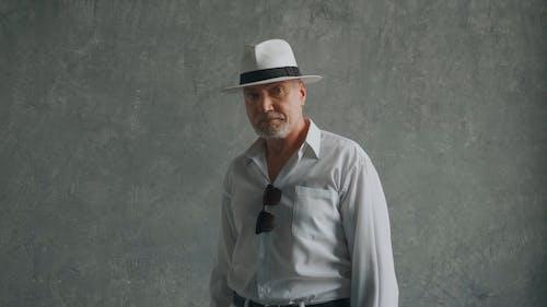 Elderly Man Wearing White Fedora Hat