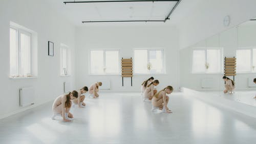 Ballerinas Dancing in Front of a Full Length Mirror