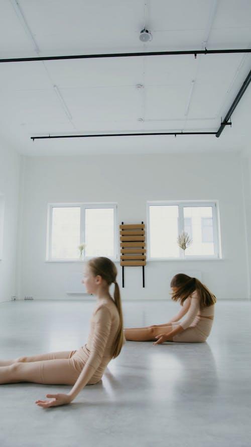 Ballerinas Dancing on a Dance Studio