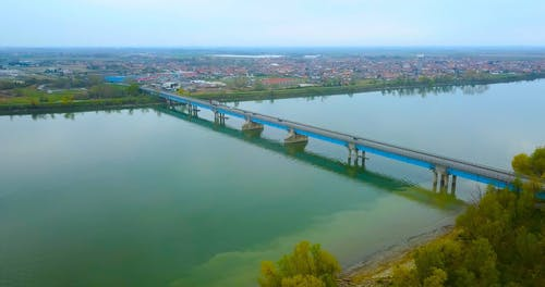 Drone Footage of Bridge and Lake