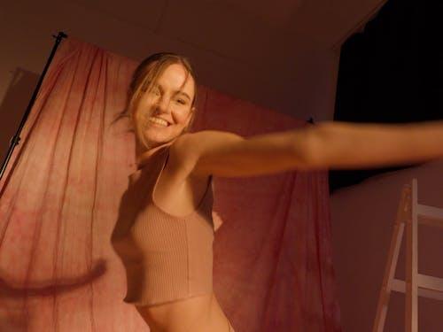 Woman is Dancing while Wearing Bikini