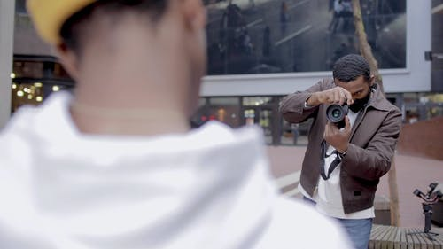 Photographer Taking Picture of a Man