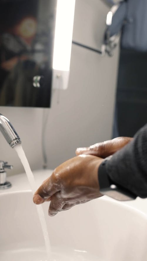 Close-Up View of a Person Washing Hands