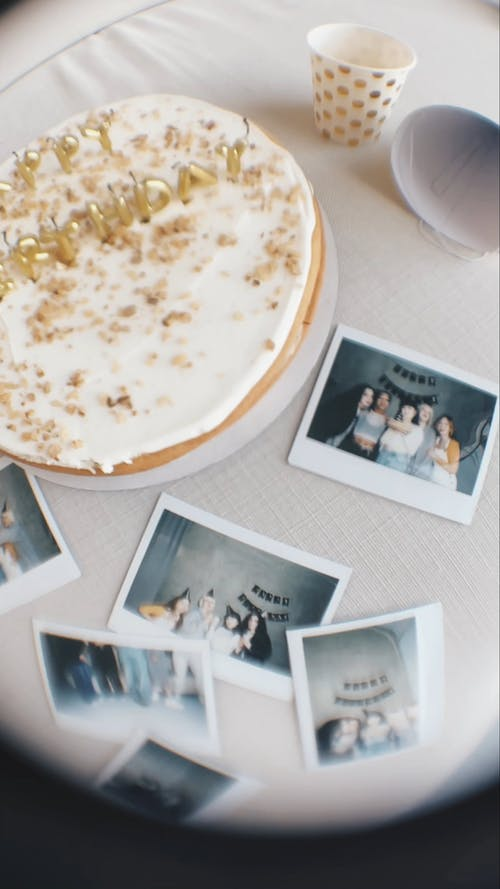 Fisheye Video of a Birthday Cake and Polaroid Pictures