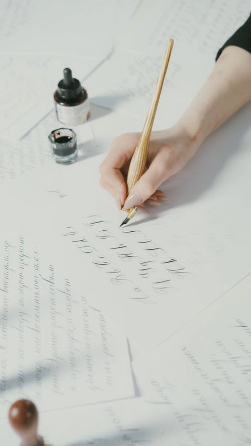 Person Writing using Pen and Ink