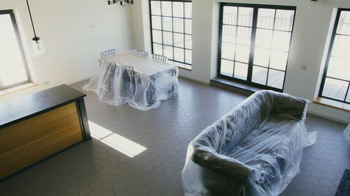 Plastic Covered Furniture in a Room