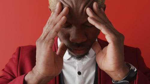 Close Up of a Man Holding his Head