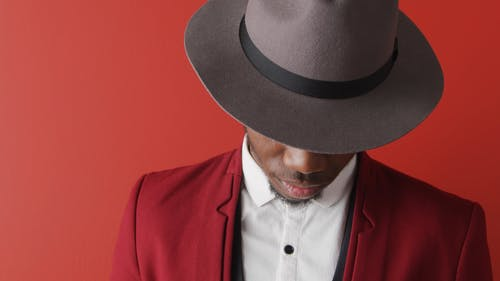 Man with Red Suit and a Hat