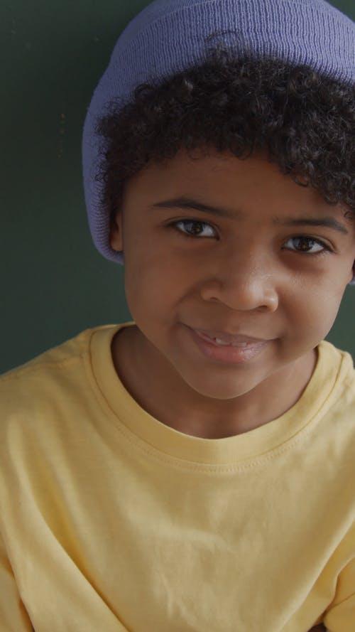 Cute Boy Wearing Purple Beanie