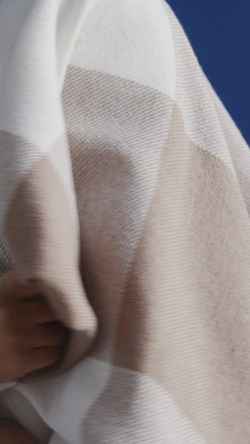 Boy Hiding Under a Blanket
