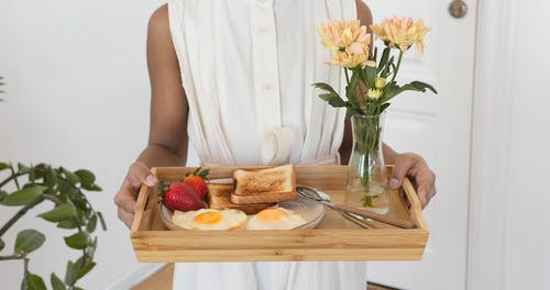 Cute Girl Holding Tray with Breakfast