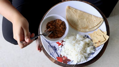 Person Eating Indian Food