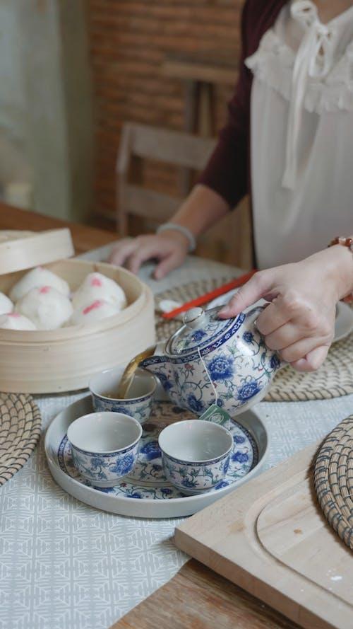 A Woman Pouring Tea