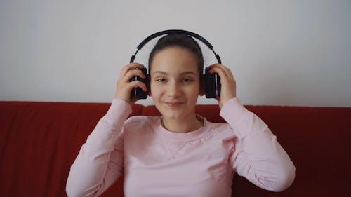 Young Woman Wearing Wireless Headphones