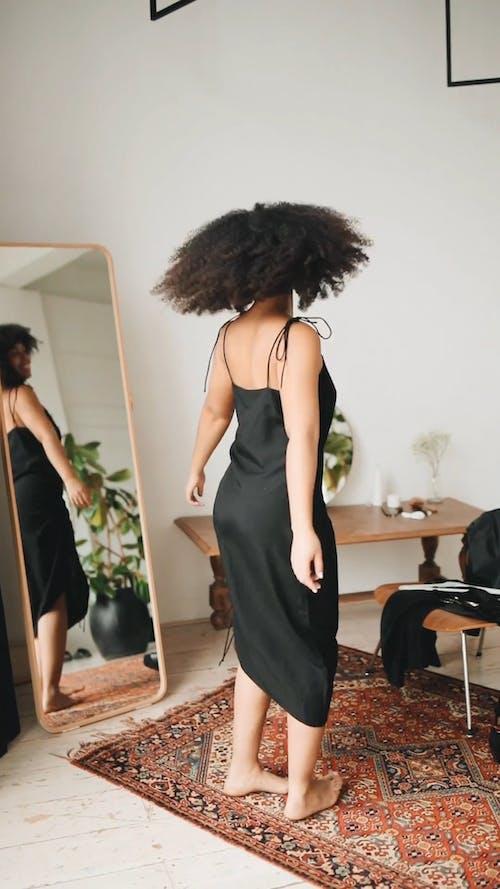 Woman Wearing Black Dress Dancing