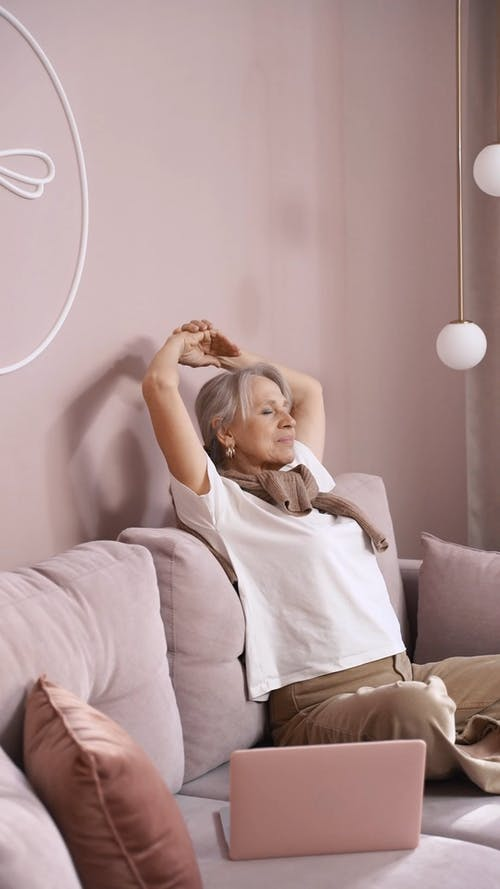 Woman Stretching On a Sofa