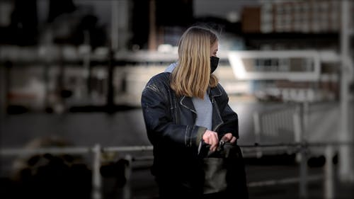 Woman in Spotlight Looking at Camera