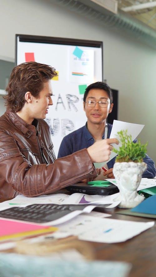 Men Having Conversation at a Meeting